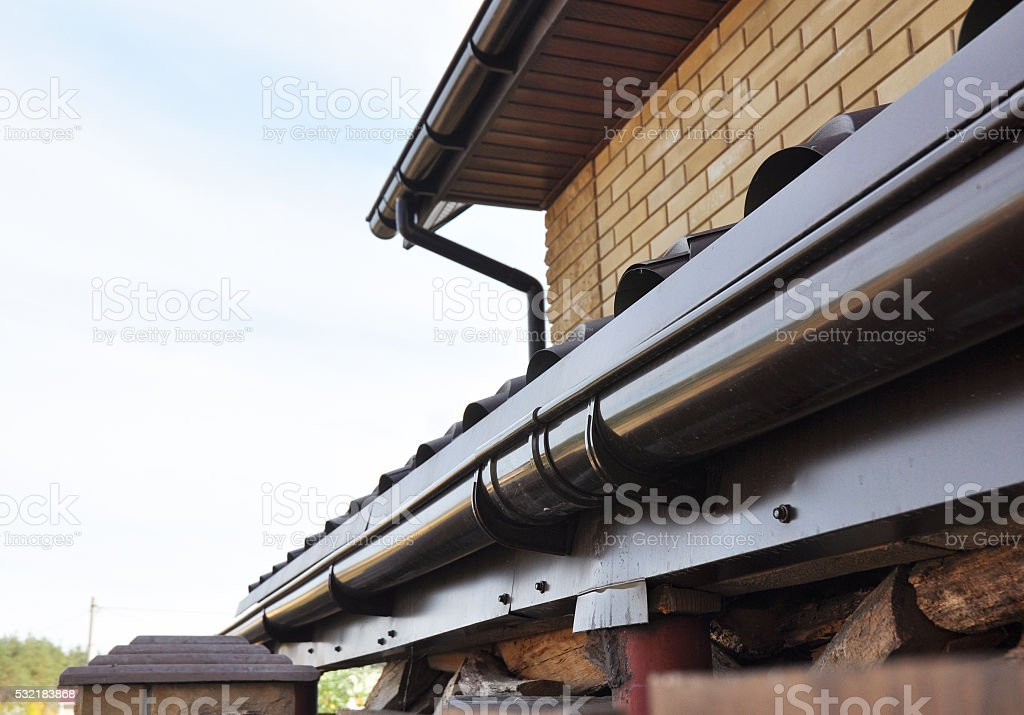 Holder gutter drainage system on the roof. stock photo