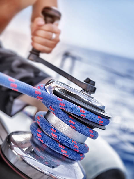 holder of rope on sailboat - cable winch stock photos and pictures