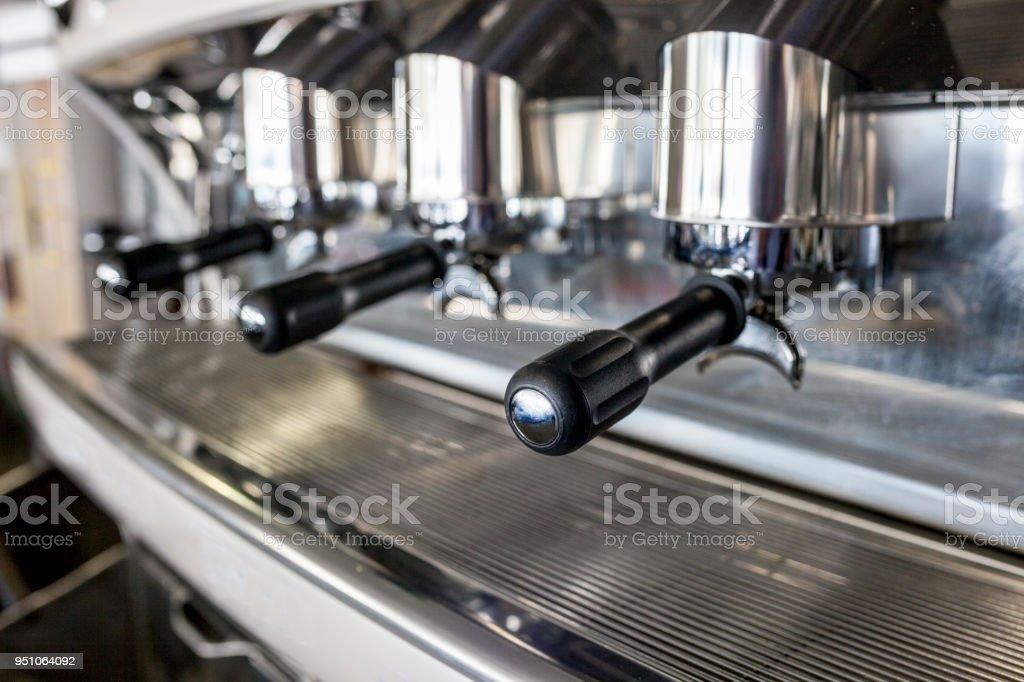 Holders on new vintage bar coffee machine. Selective focus
