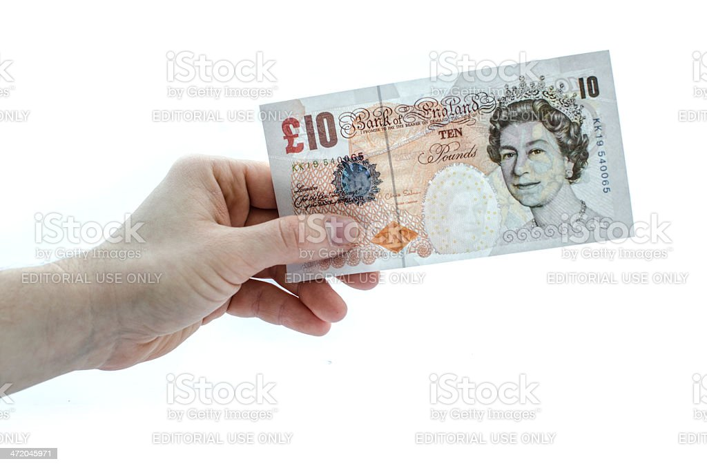 Holding a 10 pound note stock photo
