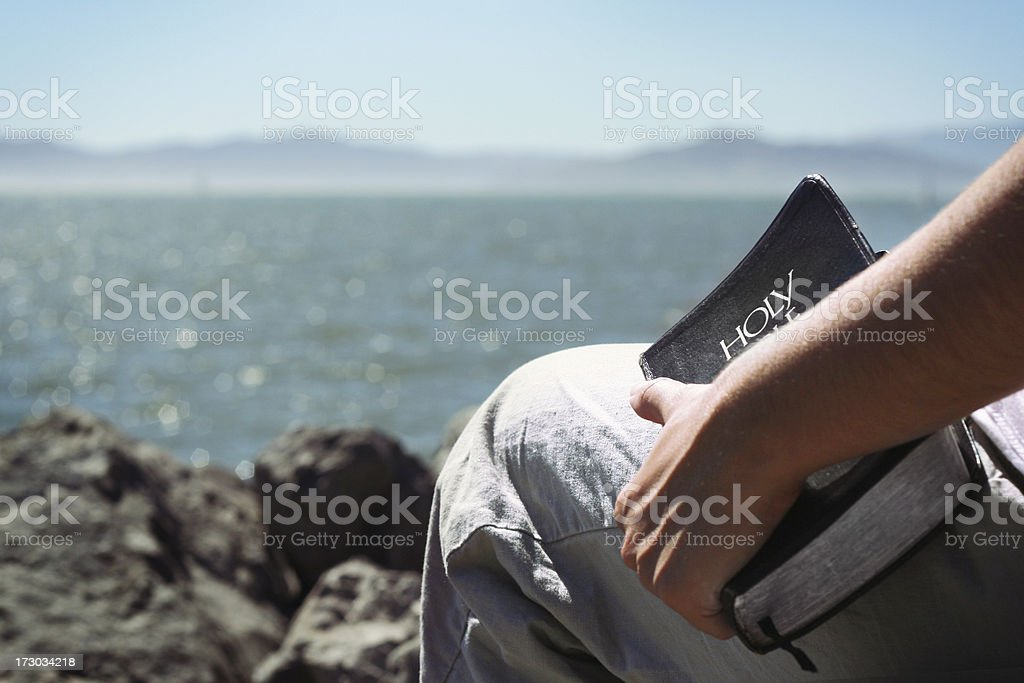 Holding a Bible stock photo