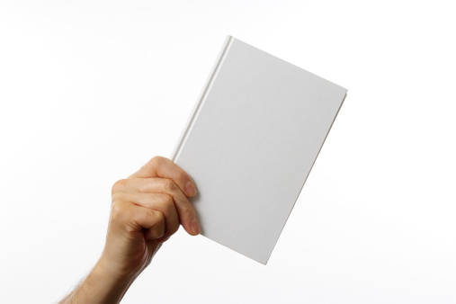 Holding a blank book against white background