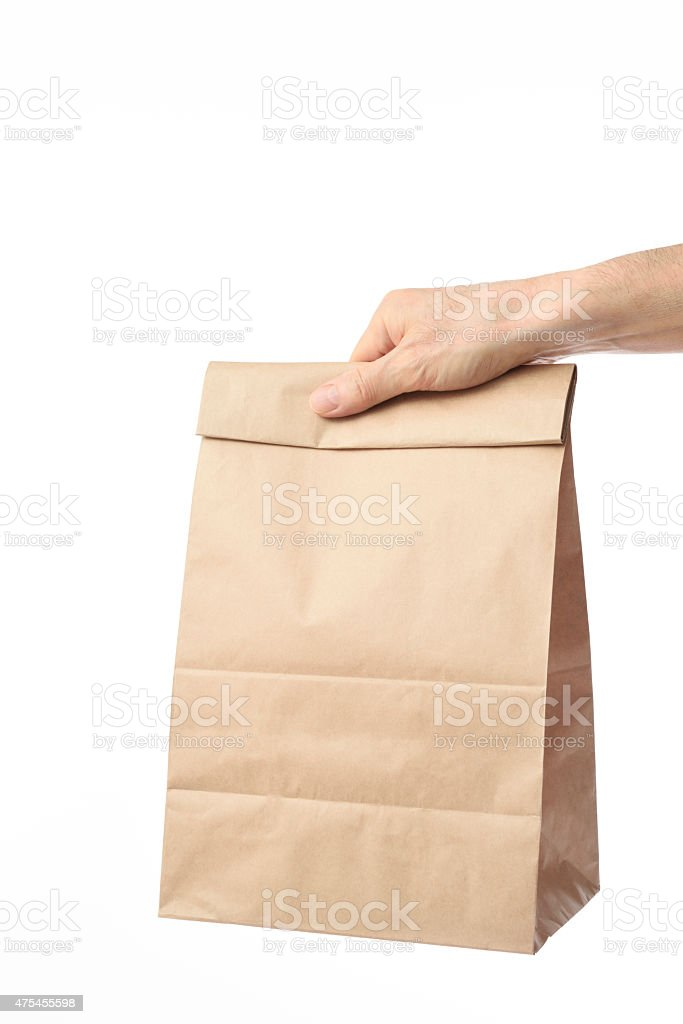 Holding a blank brown paper bag on white background stock photo