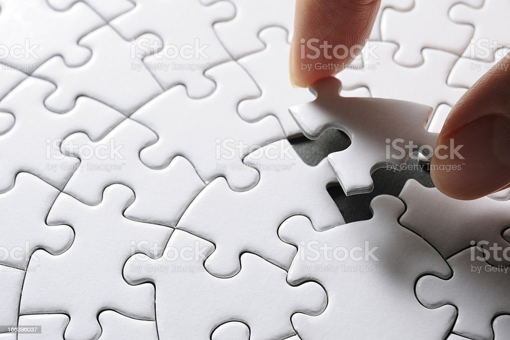 Holding a blank final piece of the jigsaw royalty-free stock photo