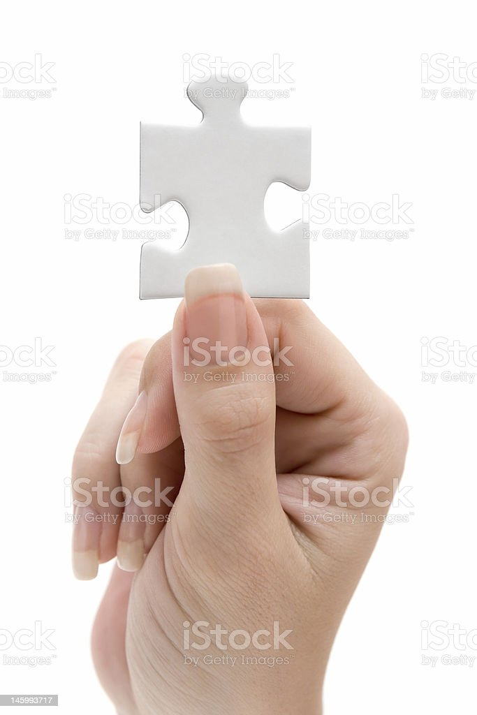 Holding a Blank Jigsaw Piece stock photo