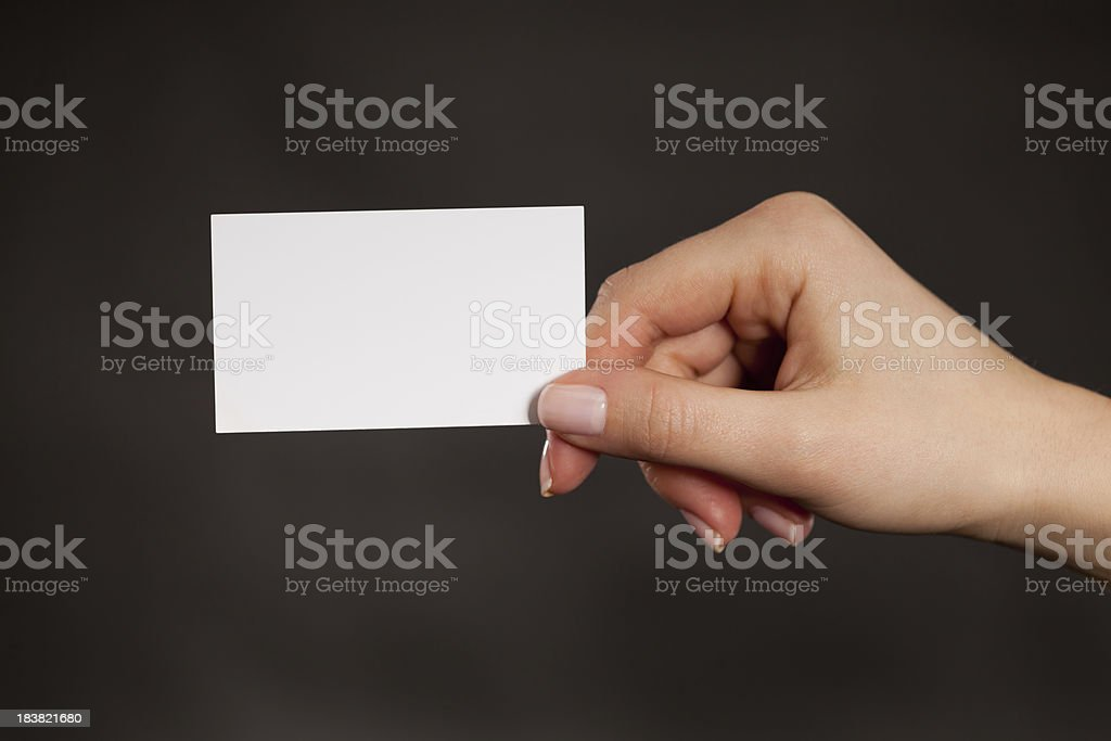 Holding a blank white business card royalty-free stock photo