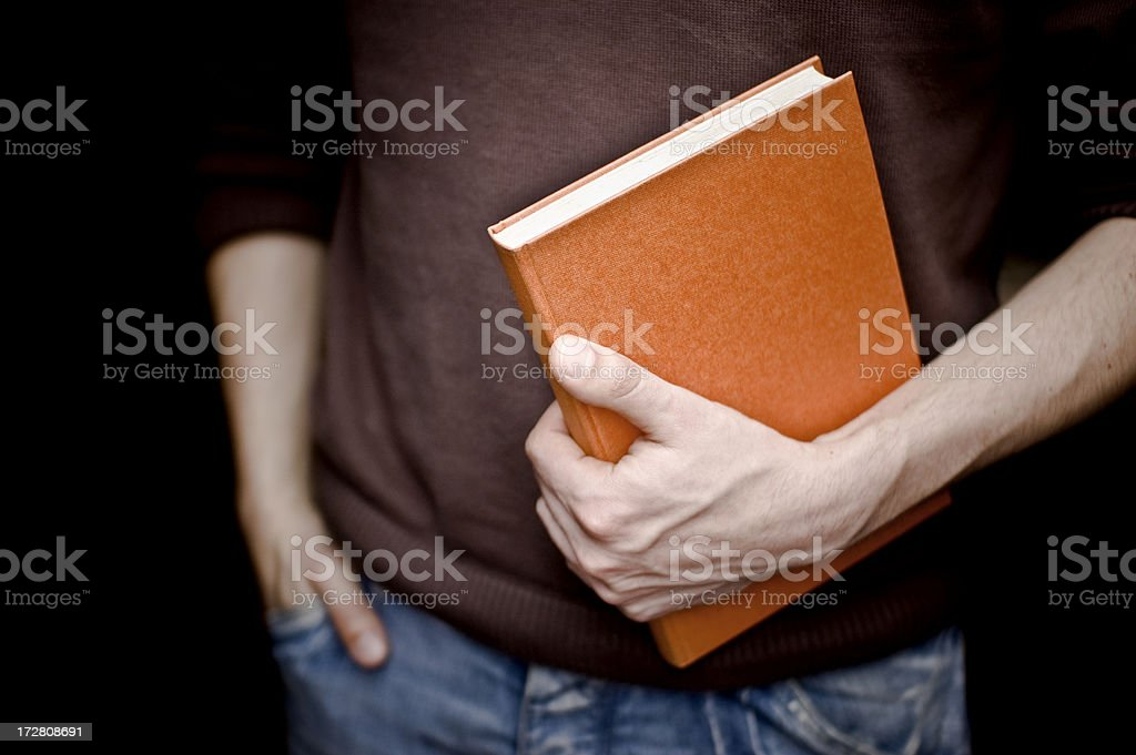 Holding a Book royalty-free stock photo