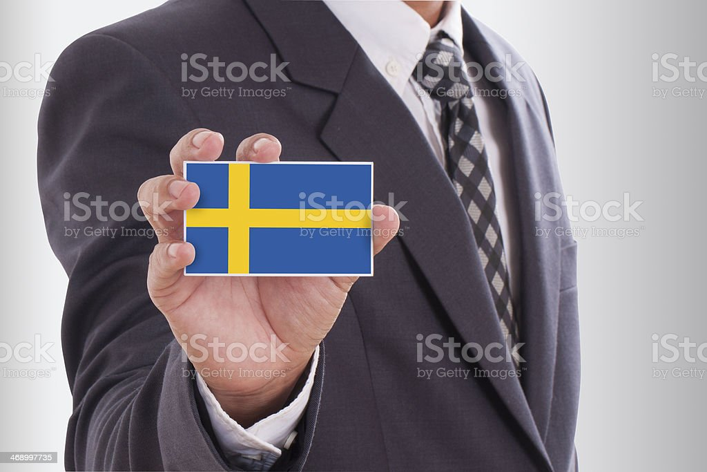 holding a business card with Sweden Flag royalty-free stock photo
