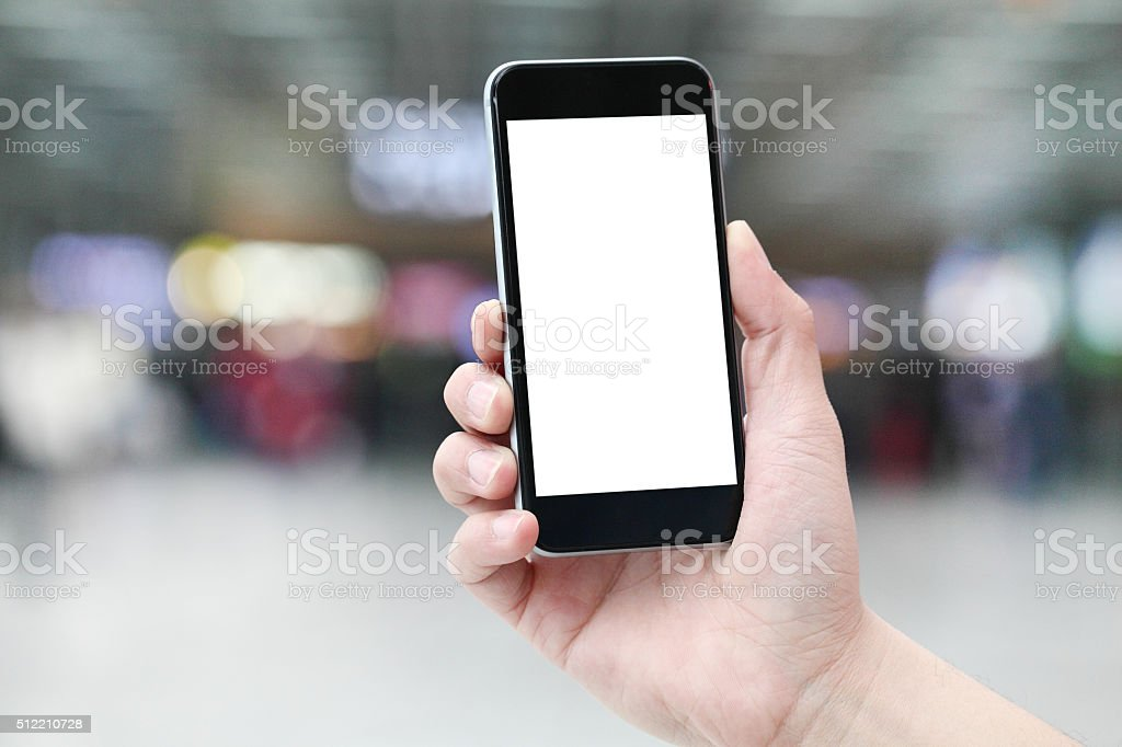 Holding a cell phone. stock photo