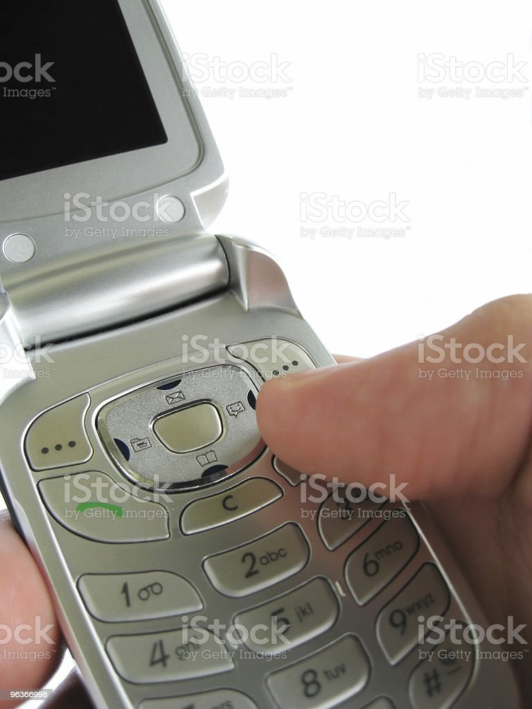 Holding a cellphone royalty-free stock photo