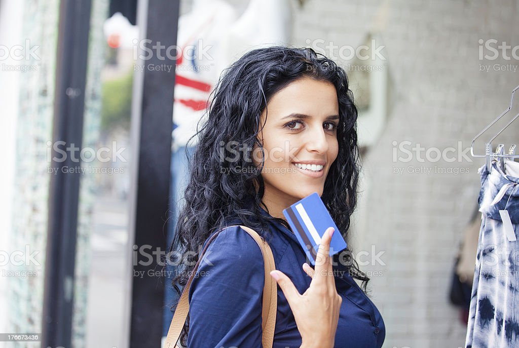 Holding a credit card royalty-free stock photo