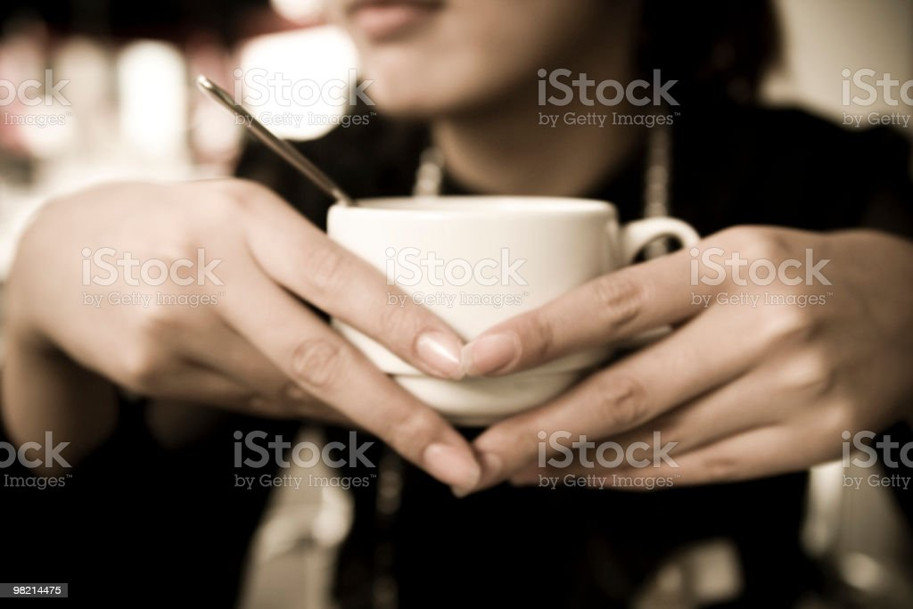 Holding a cup royalty-free stock photo