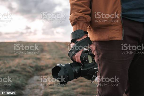Holding a dslr camera picture id871365994?b=1&k=6&m=871365994&s=612x612&h=enf 70lxb5kl1mjabwalha8ioftxwv6w7e hcyhtogc=