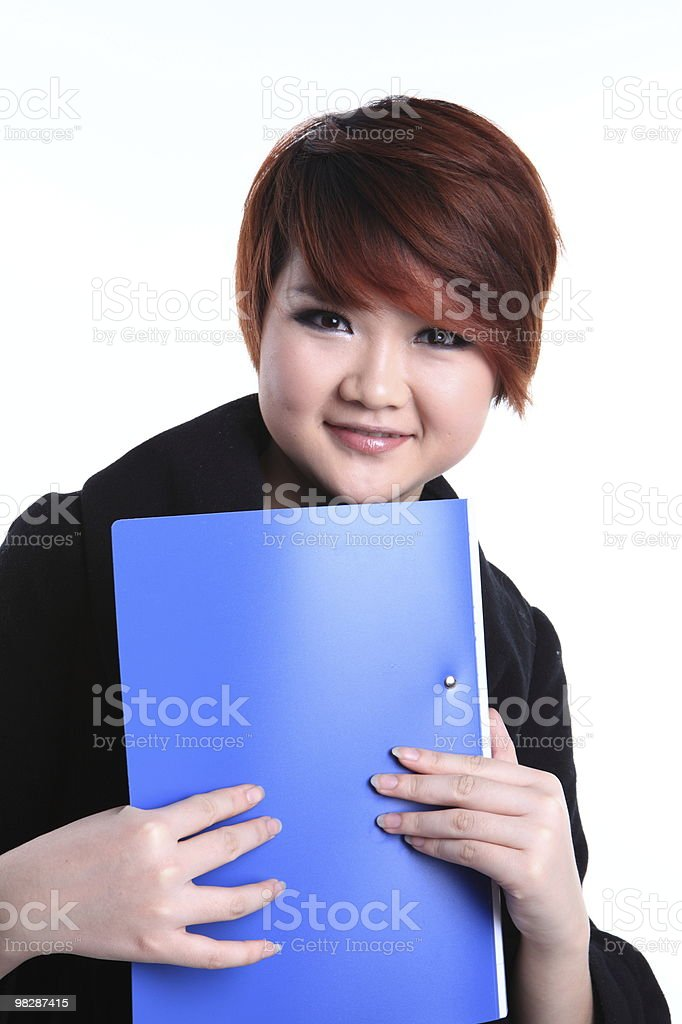 Holding a folder of Asian female students royalty-free stock photo