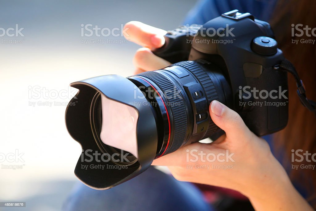 Holding a Full Frame Camera. stock photo