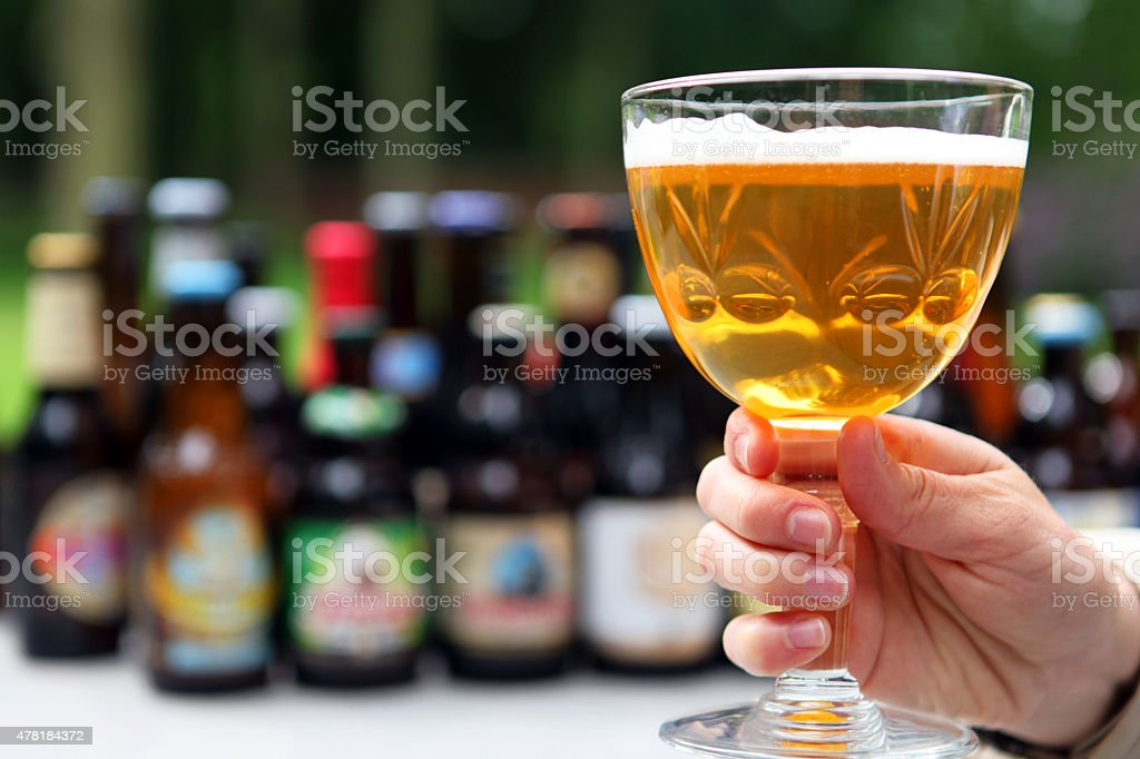 Holding a Full Glass of Belgian Beer stock photo