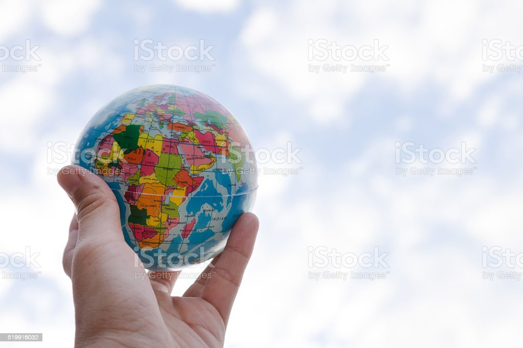 holding a globe in his hand, environment and business concept stock photo