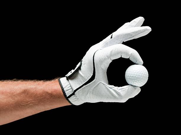Holding a Golf Ball stock photo