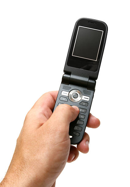 Holding a GSM cell phone stock photo
