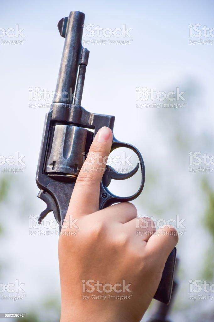 holding a gun stock photo