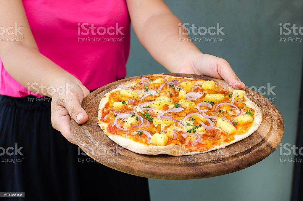 Holding a Hawaiian Chicken BBQ Italian Pizza foto stock royalty-free