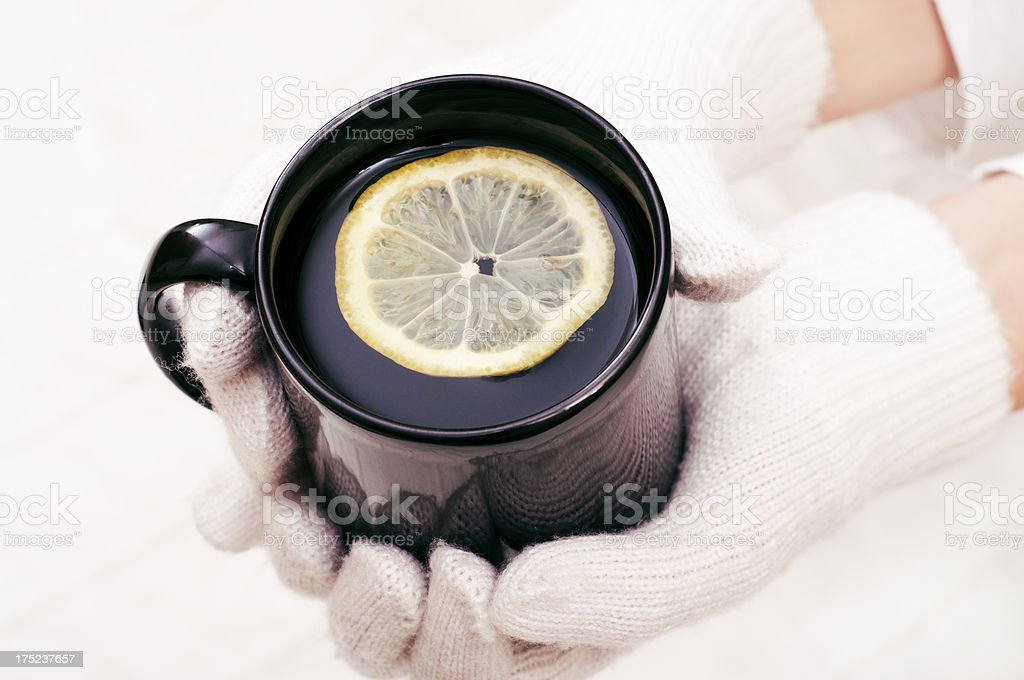 Holding a hot drink royalty-free stock photo