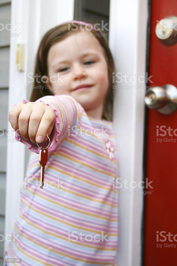 Holding a Key royalty-free stock photo