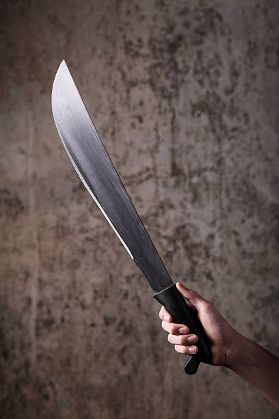 Holding a Machete stock photo