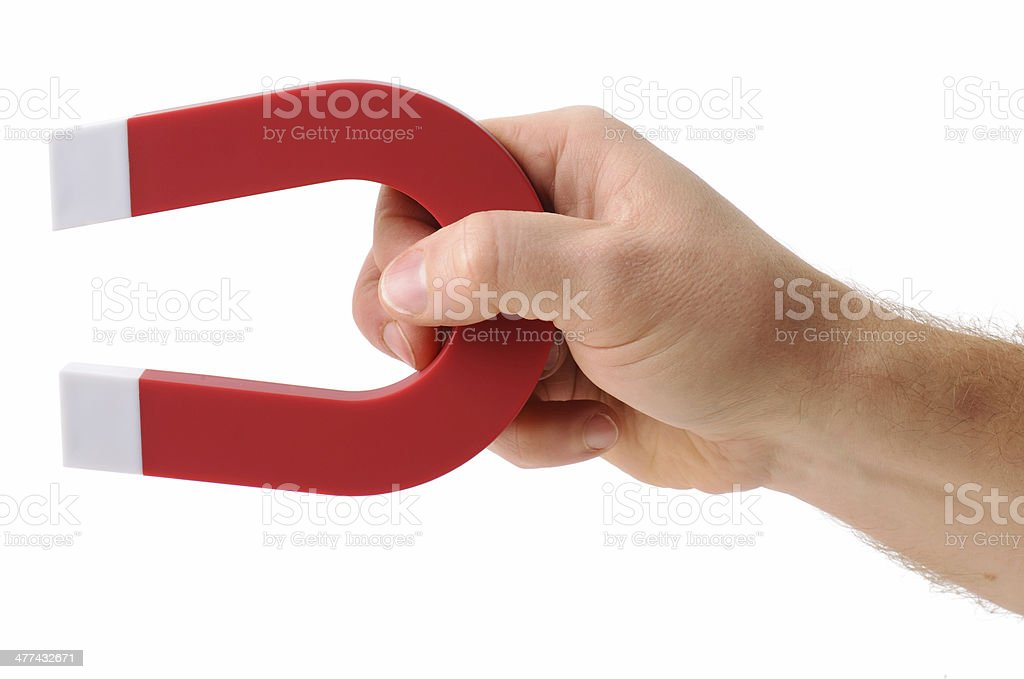 Holding a magnet stock photo