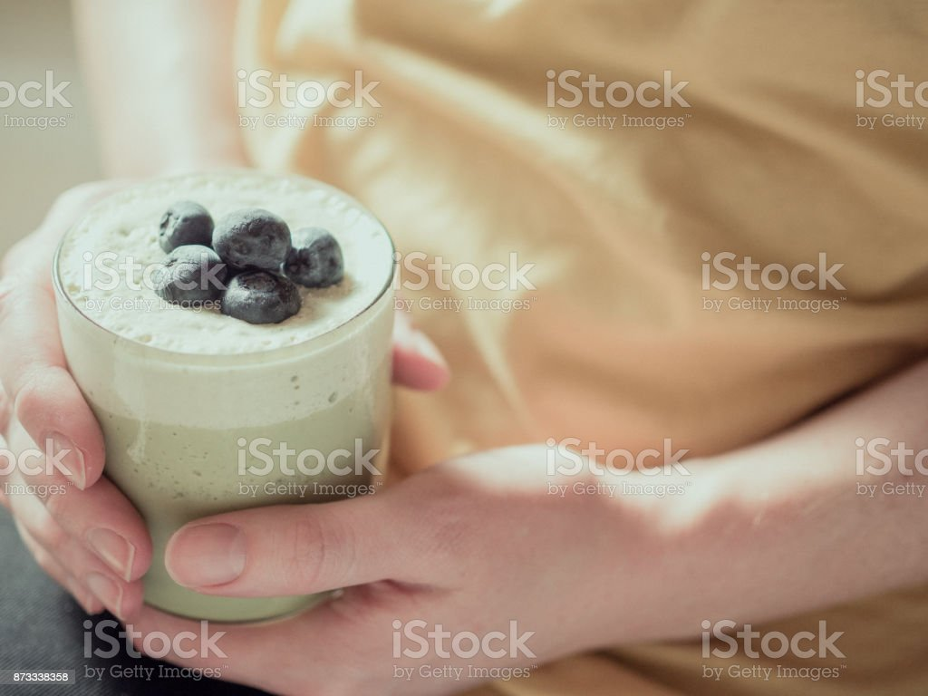 Holding a Matcha Smoothie stock photo