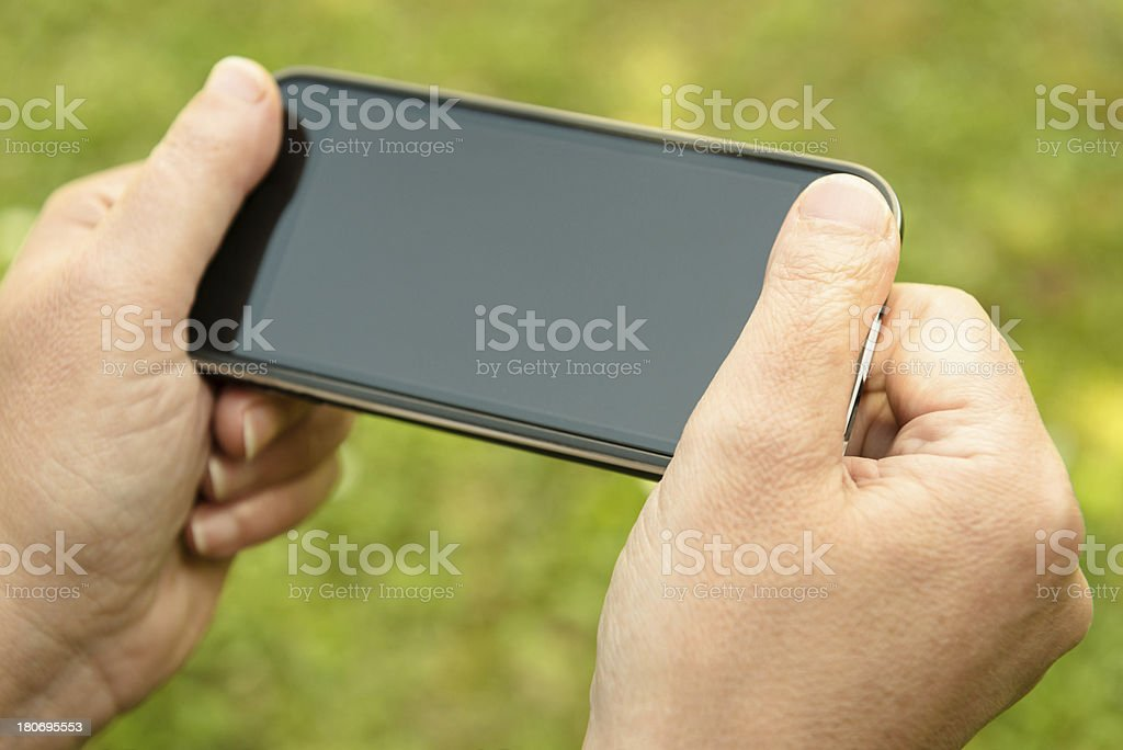 holding a new smartphone royalty-free stock photo