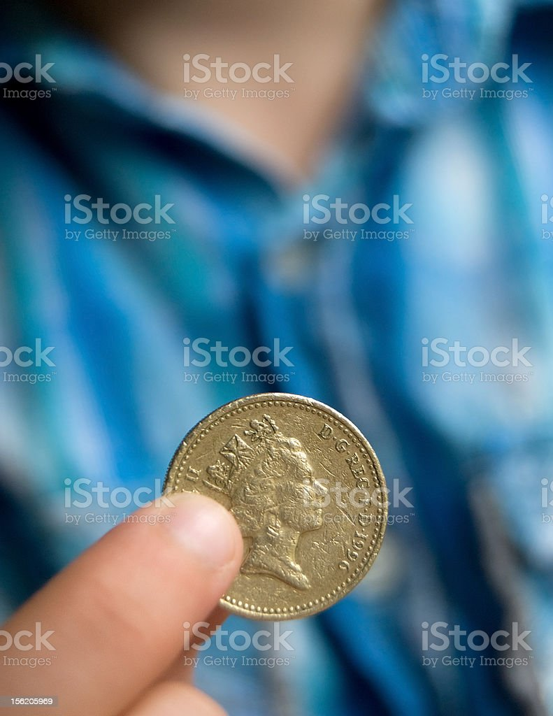 Holding a one pound coin stock photo
