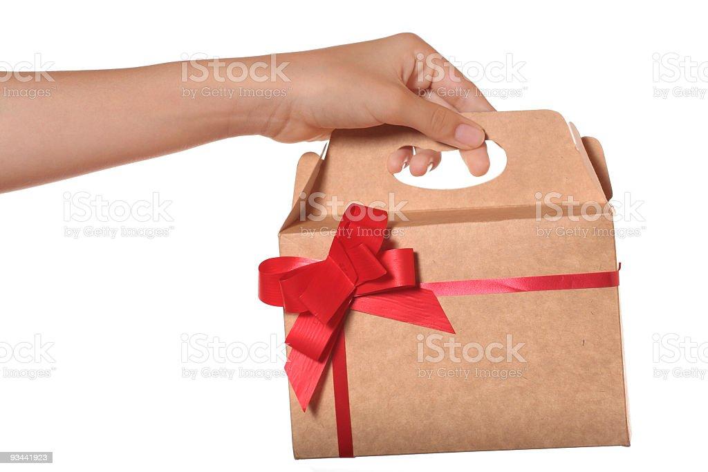 Hält ein Geschenk Lizenzfreies stock-foto
