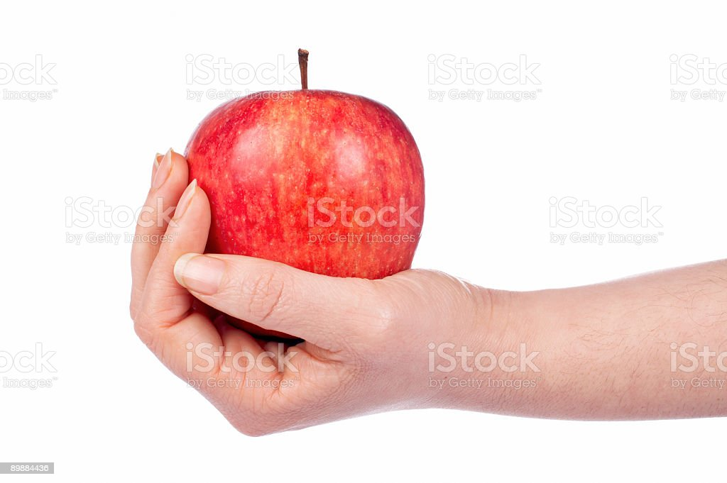 Holding a red apple royalty-free stock photo