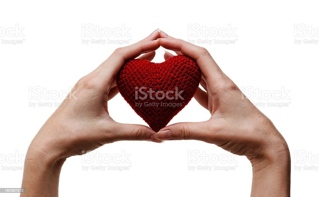 holding a red heart in hands royalty-free stock photo