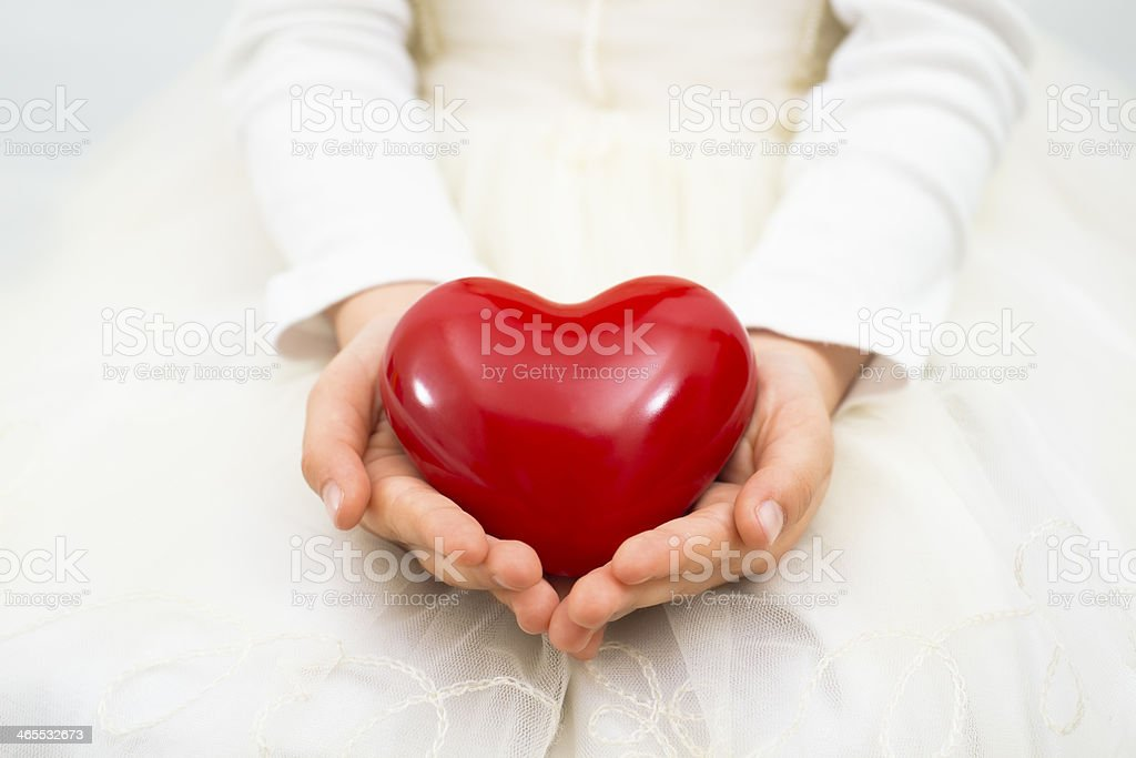 Holding a red heart royalty-free stock photo