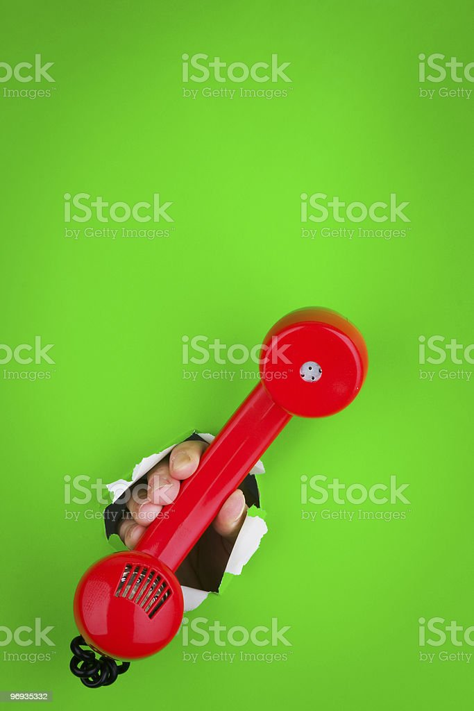 Holding a red phone royalty-free stock photo