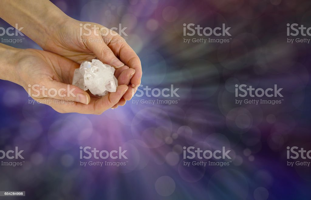 Holding a Reiki Master Apophyllite Crystal Cluster stock photo