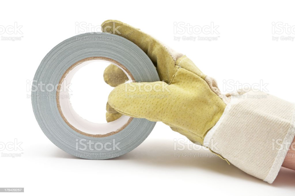 Holding a Roll of Gray Duct Tape stock photo
