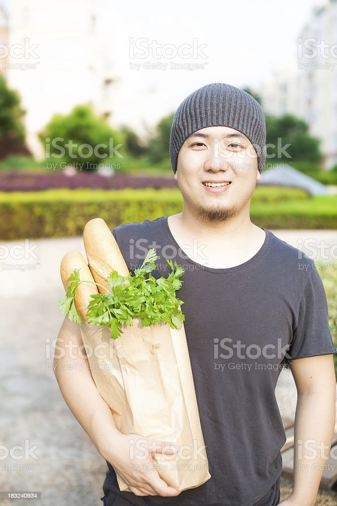 Holding a sack of vegetables royalty-free stock photo