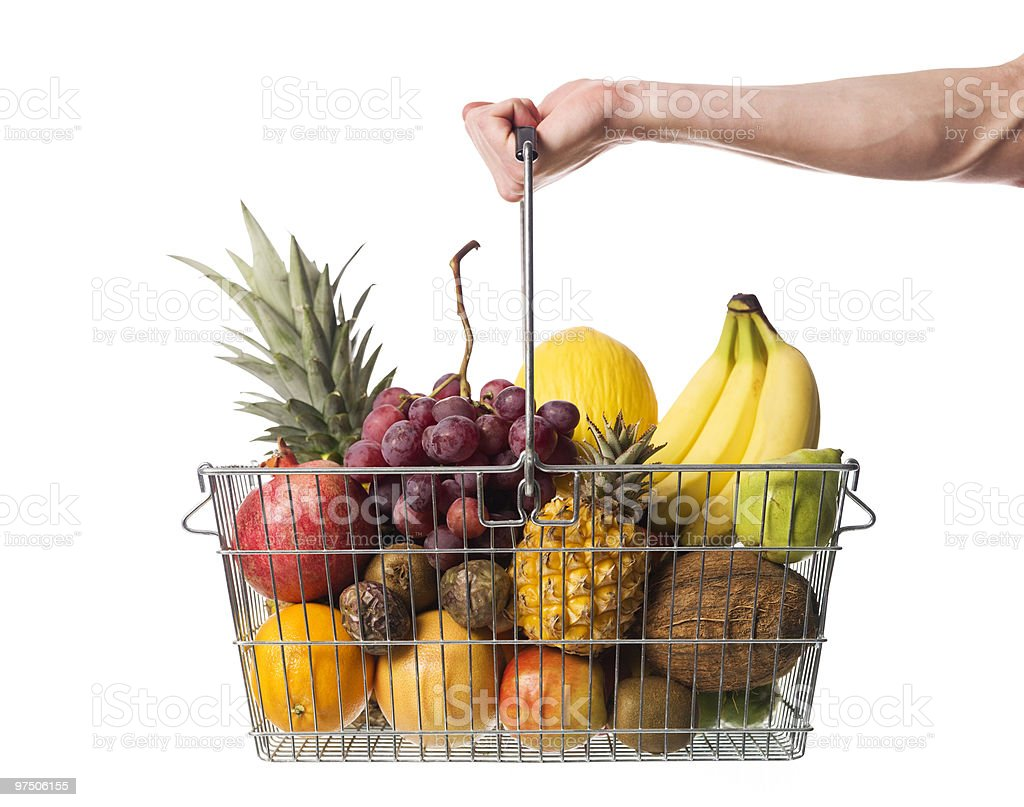 Holding a shopping-basket with fruit royalty-free stock photo