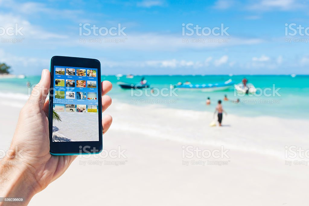 Holding a smartphone in caribbean Punta Cana of Dominican Republic royalty-free stock photo