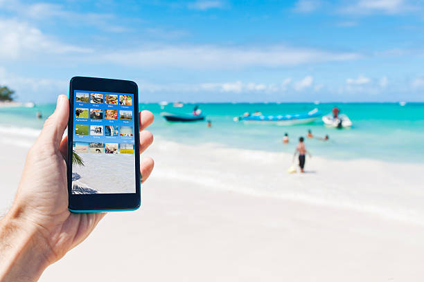 Holding a smartphone in caribbean Punta Cana of Dominican Republic stock photo