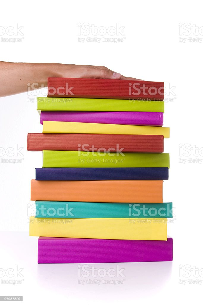 holding a stack of books royalty-free stock photo