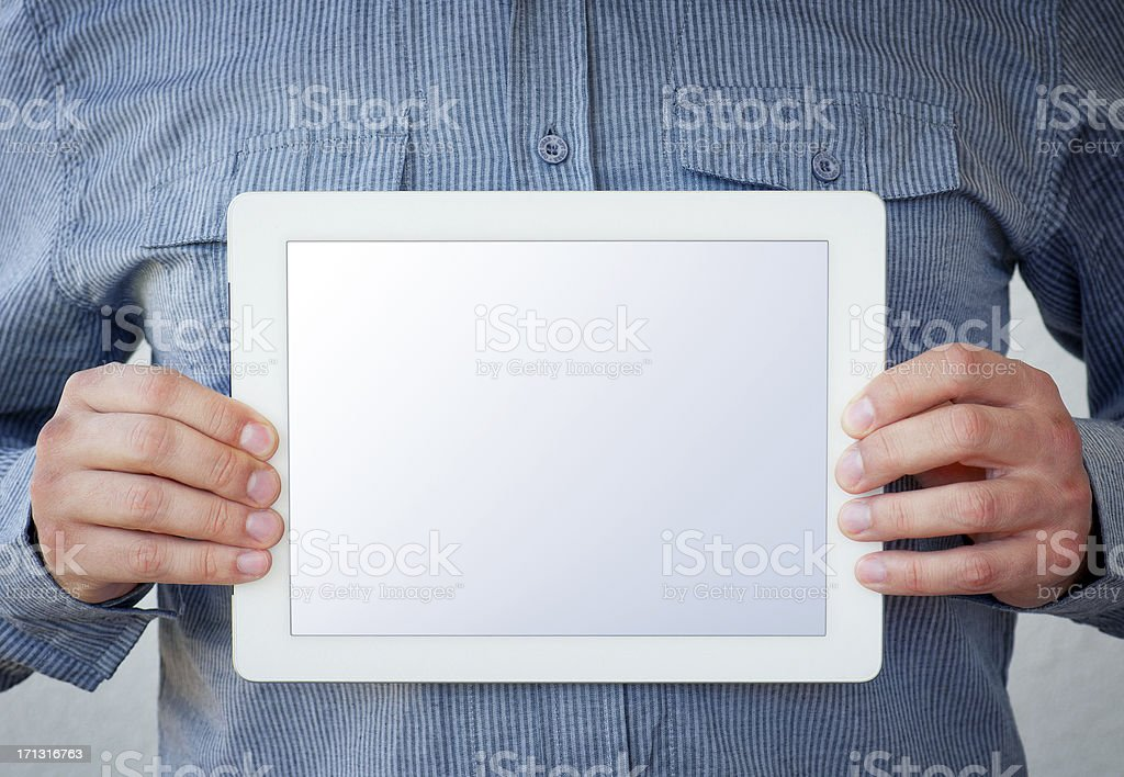 Holding a Tablet Computer - clipping path for screen included royalty-free stock photo