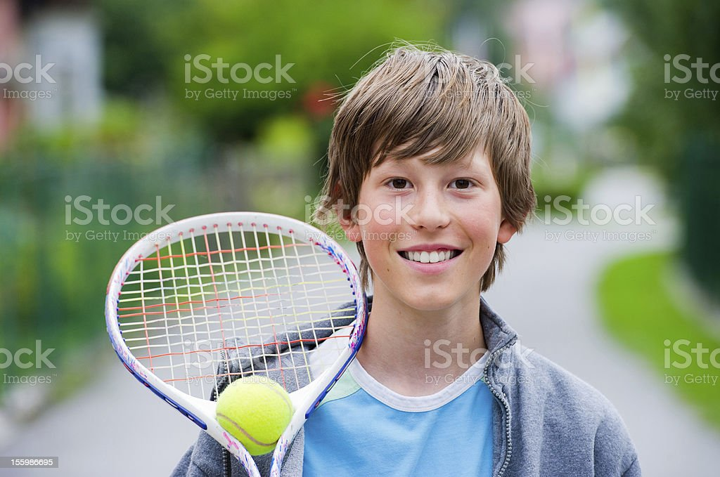 Holding a tennis racket royalty-free stock photo