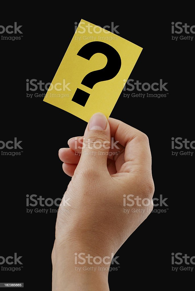 Holding a yellow question card stock photo