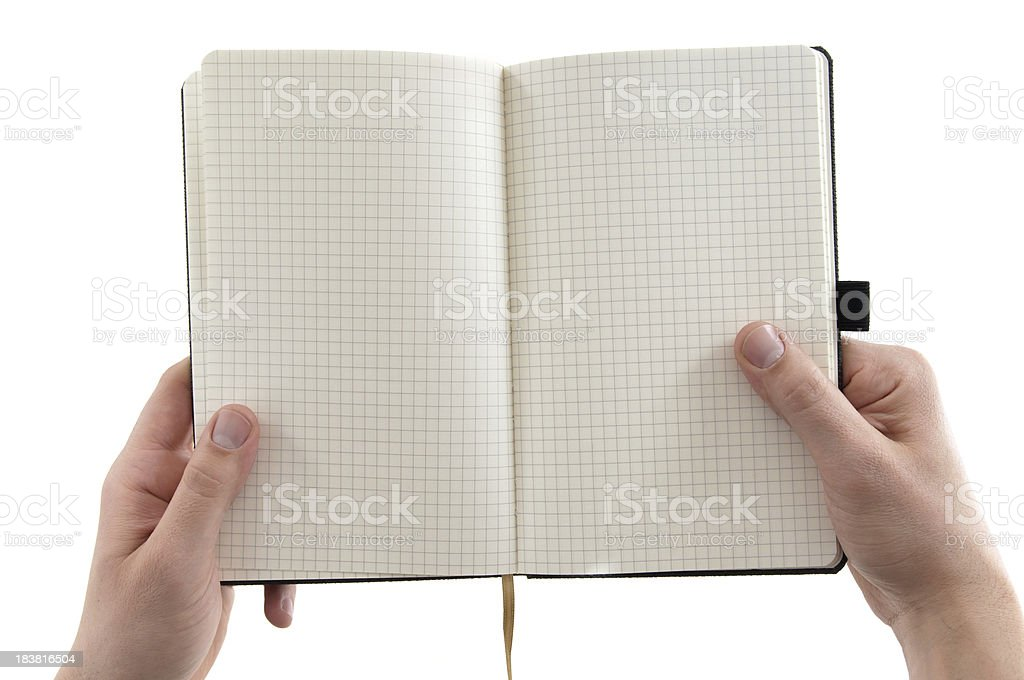 holding an open notebook royalty-free stock photo