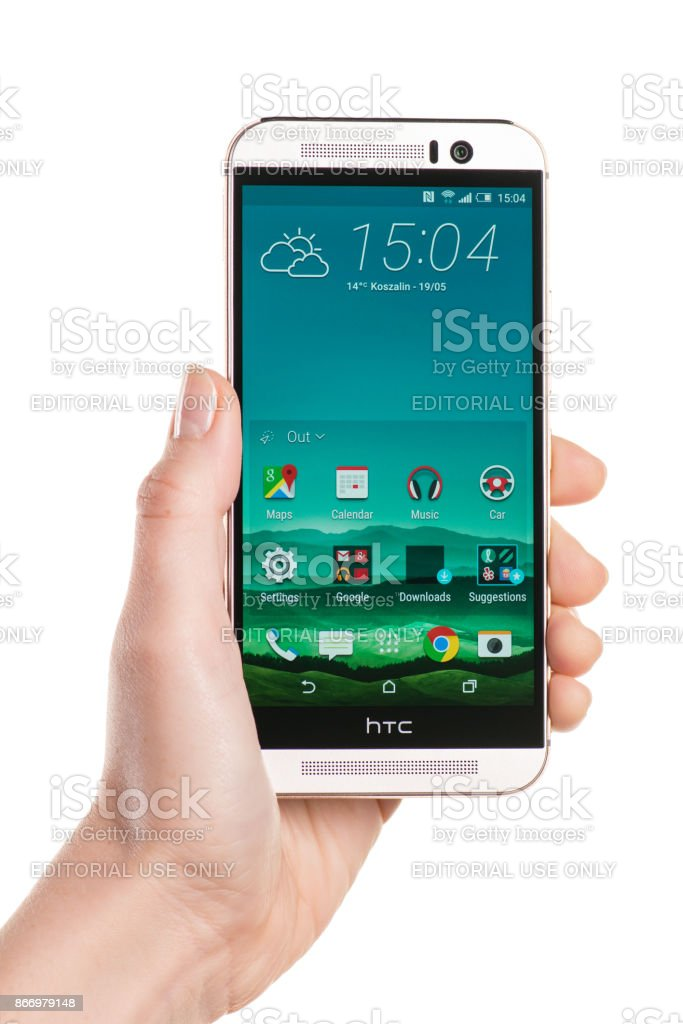Holding Android smartphone HTC One M9 in a left hand stock photo