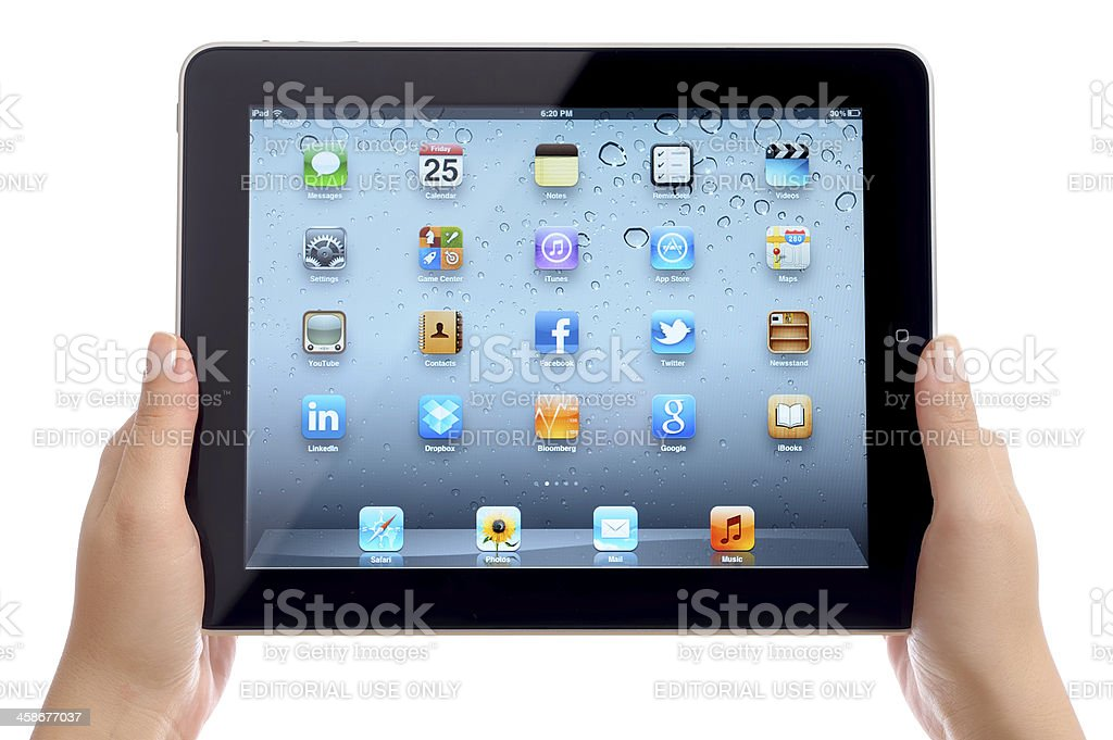 Holding Apple iPad iOS 5 royalty-free stock photo